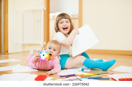 Two happy children  in home interior
