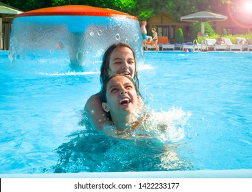 Two happy children playing on the swimming pool at the day time. Concept of friendly family.