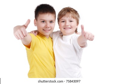 two happy children with thumbs up