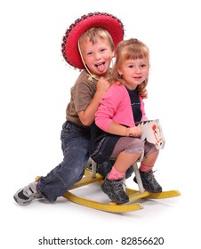 Two happy childs on a rocking horse.