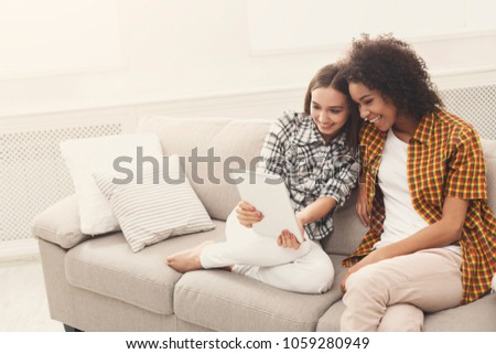 Two Happy Female Friends Using Digital Stock Photo (Edit Now