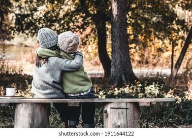 Two happy girls as friends hug each other. Little girlfriends in park. Children Friendship.