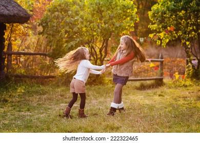 Two happy kids having fun the park. Autumn concept