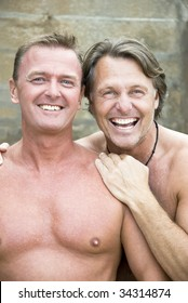 Two happy laughing gay men in their forties.