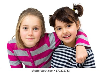 two happy little girls isolated on white