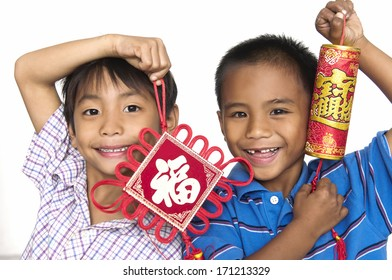 Two happy little young boy holding chinese lucky word for chinese new year