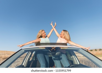 Two happy sister in car happy and smiling after shopping