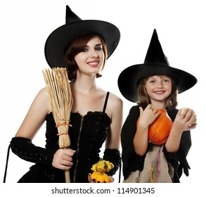 two happy sisters with halloween masks - white background