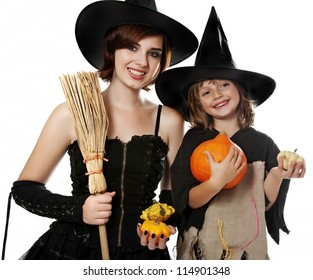 two happy sisters with halloween masks