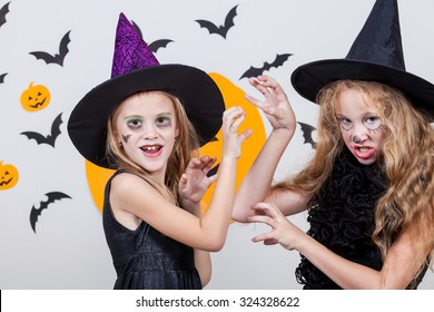 Two happy sisters on Halloween party