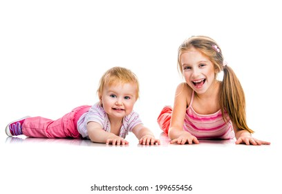 two  happy sisters in studio on white background