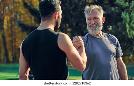 The two happy sportsmen greeting outdoor