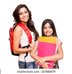 Two happy students posing over white background