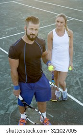 Two Happy Tennis Players having fun to play