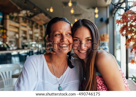Two happy women in a cafe
