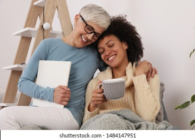 Two Happy women laughing , Multi ethnic family, Mother and Daughter, Support, Advice . Cozy Home Atmosphere