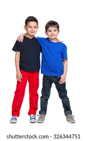 Two happy young boys stand together against the white background