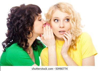 two happy young girlfriends talking over white