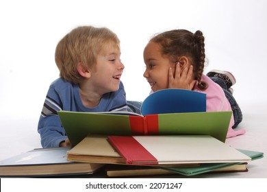 two happy young kids reading books together