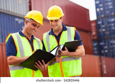 two harbor workers working at container yard