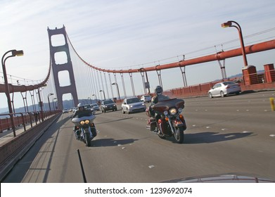 Two Harley-Davidson motorcycles driving over the Golden Gate bridge in San Francisco, California / United States of America, February 21 - 2009