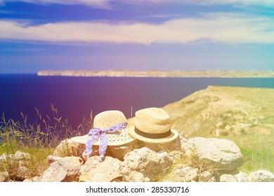 two hats on vacation in mountains at the sea, mountains vacation concept