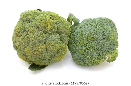 Two heads of calabrese broccoli in comparison - beginning to perish and fresh - on a white background