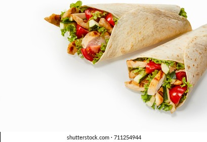 Two healthy fresh chicken and salad wraps on white background with copy space