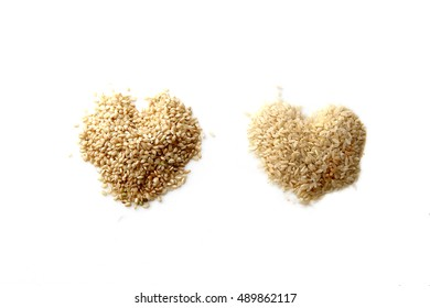 Two hearst shaped brown rice isolated on white background