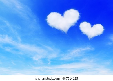 63048f97bf7 it is two heart shaped clouds on blue sky for valentine background.