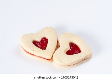 Two heart shaped cookies for Valentines Day.