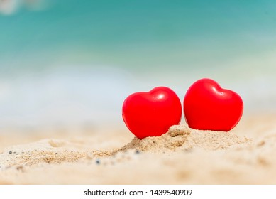 Two Hearts couple lover symbol on honeymoon day trip in tropical paradise island with banner copy space. Romantic red hearts objects on wedding anniversary for couple lover. Honeymoon tourism concept.