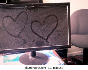 Two Hearts Drawn on Dusty Computer Monitor in an Office