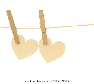 two hearts hanging on rope and white background
