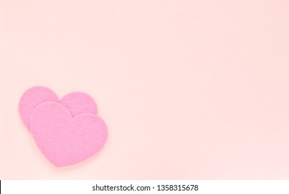 Two hearts on light background, copy space. Valentine's Day concept
