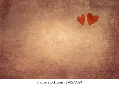 Two hearts on vintage wooden background. Space for text