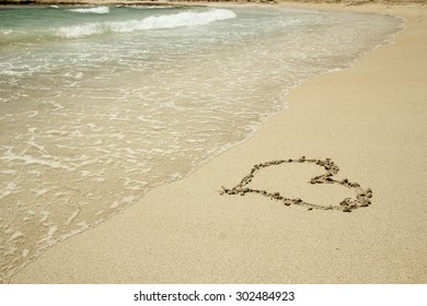 a two hearts in the sand on the beach