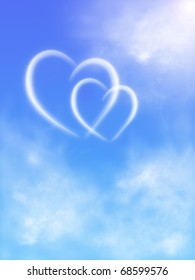 two hearts in the sky with clouds