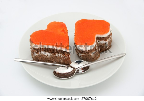 Two heart-shaped cakes on the plate