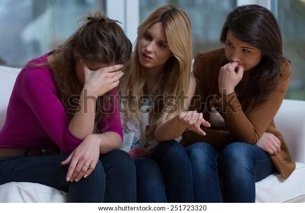 Two helpful girls talking with broke down friend