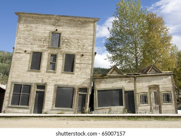 Two heritage buildings in Dawson city, Yukon, slant towards each other due to melted permafrost