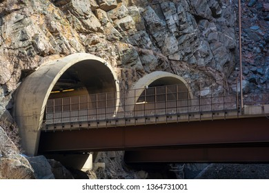 Two Highway Tunnel Entrances cut into a Mountainside