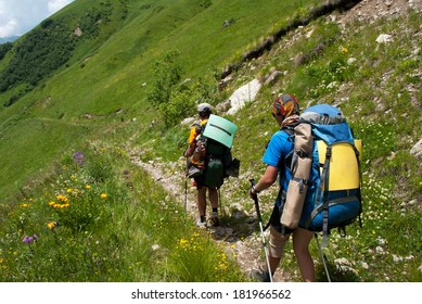 two hikers with backpack in Georgia mountains