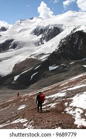 Two hikers descending Aconcagua's Normal Route