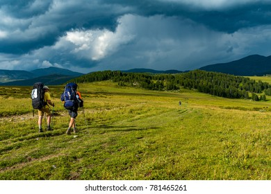 Two hikers go to meet rage, Altay, Siberia, Russia, Autumn