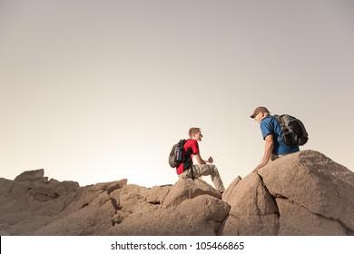 Two Hikers Take A Break on Rocky Terrain
