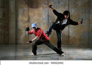 Two hip-hop dancers performing with a grungy background