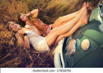 two hippie girls in the grass