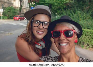 Two Hipster Young Girls Taking Selfie In Park