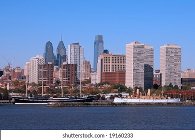 "Two Historic ships, the square-rigged sailing ship ""Mosholu"" and the cruiser USS Olympia, are moored at Philadelphia's Penn's Landing"